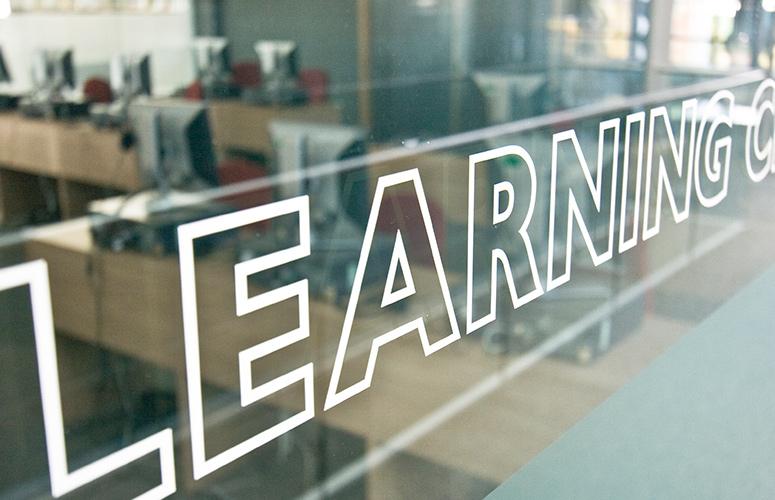 vinyl typography window wayfinding
