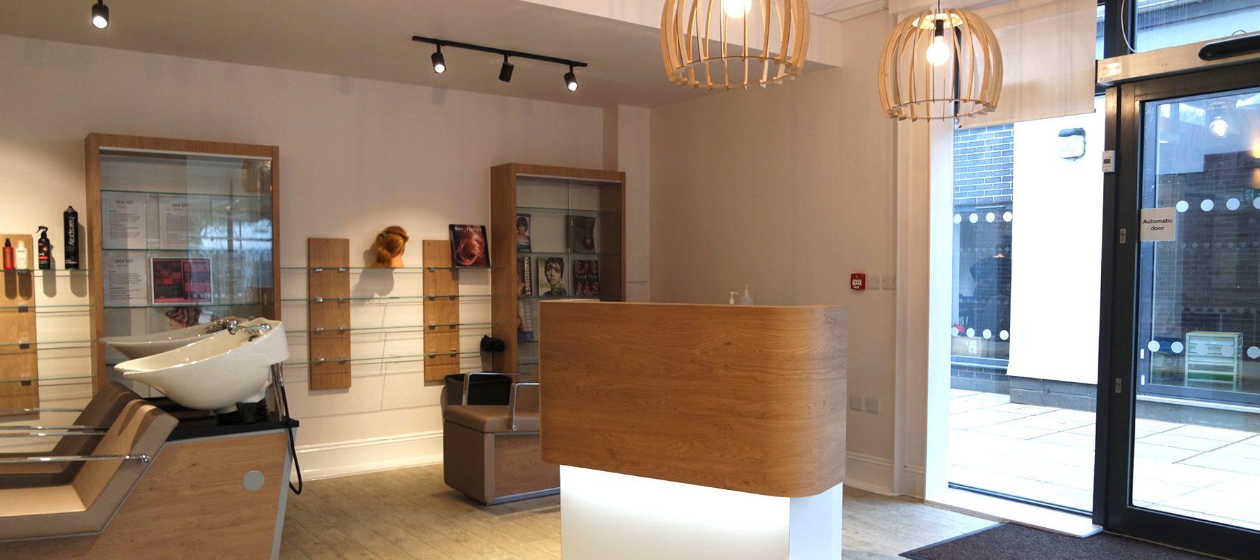 booking desk hair beauty salon feature light interior design inspiration